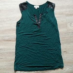 Green tank with black leather accents